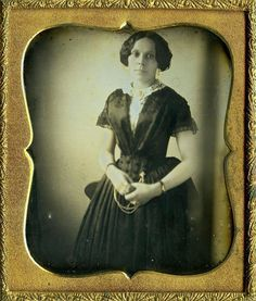 A grand image from the 1840s. I luv that she is sleeveless. Her camisette is very fine. I couldn't resist the chatelaine and the ring on her forefinger.