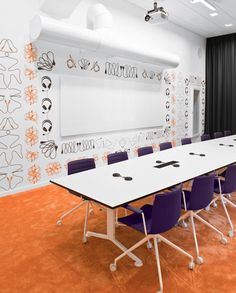 Purple Catifa meeting room chairs and white meeting table