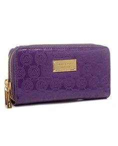 "Michael Kors Jet Set Monogram Mirror Metallic Continental Clutches Violet    PRODUCTS DESCRIPTION  * Choose Bronze monogram metallic leather.  * Violet hardware.  * Continental zip closure.  * Signature Michael Kors logo plate at top center.  * 4""H x 8 1/4"" x 3/4""D.  * Imported."