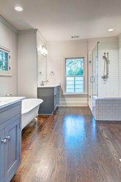 Double vanities, claw foot tub, hardwood floor