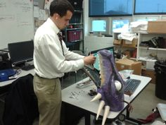 Mitch '14 working on the robotic dragon for Shrek the Musical.