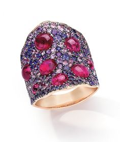 Cellini Jewelers Cabochon ruby's set in a pave of purple sapphires , set in 18 k rose gold Cabochon Ruby 4.34ct . Purple sapphires, 3.80 ct