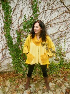 Yellow poncho made from old sweaters