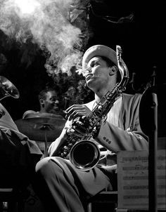 1948: Tenor saxophonist Dexter Gordon enveloped in his cigarette smoke at the Royal Roost in New York