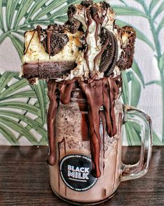 Chocolate Milkshake topped with a whole slice of Oreo Brownie Cheesecake - at Black Milk, Manchester, UK.