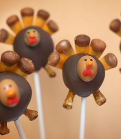 Cake pops with candy corn feathers and pretzel legs, M&M for face... cute