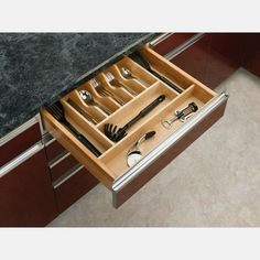 $48.99 · Organize kitchen drawers with Rev-A-Shelf's wood cutlery tray insert. The tray insert series is made of classic maple hardwood with a UV cured clear finish to ensure an acceptable match to any kitchen cabinet. This modern-day clutter solution requires a simple drop-in installation with a size that may be trimmed to fit the drawer. #kitchendesign #kitchendrawers