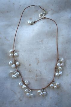 White freshwater pearls on leather necklace