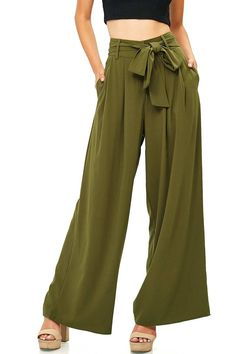 """Chiffon pants with dramatic wide-leg fit and pleating at the top with an adjustable waist tie. Pockets on the sides and a clasp and zipper closure. High rise fit pairs well with crop tops. *Hand Wash Cold *97% Polyester 3% Spandex *42""""/ 108 cm Top To Bottom; 29""""/ 75 cm Inseam (Model is 5'7 wearing a Size S; Measured on a Size S) *Refer to Bottoms Size Chart #2 *Imported"""