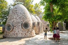 These dome-shaped housing units were designed to accommodate children from challenged backgrounds. Co Housing Community, University Of Mumbai, Louisiana Museum, Basalt Stone, Key Projects, Chief Architect, India Design, Masonry Wall, Indian Architecture