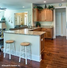 This kitchen offers beautiful hardwood floors. The Jarrell #1017. http://www.dongardner.com/house-plan/1017/the-jarrell. #Kitchen #DreamHome #HomePlan