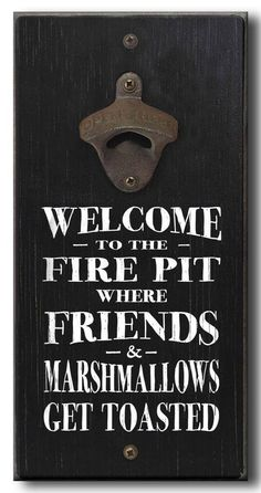 Wooden welcome to the fire pit sign with bottle opener.