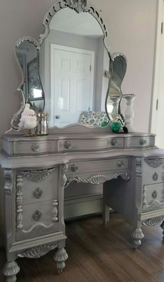This amazing 1932's Vintage Vanity & Mirror were requested to coordinate with the Jacobian buffet I recently refinished for a client. White, gray chalk paint, slightly distressed, metallic silver gilding wax, General Finishes brown glaze. Then I refinished and added new fabric to a vintage chair I had and wow! This is so beautiful. So very happy with how this came out! Love, love it Repurposed, up-cycled, DIY