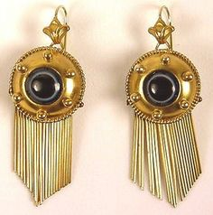 "Classical Revival ""bull's eye"" agate earrings c. 1860-1870. Cabochon agate stones (black surrounding a white circle and a very dark brown center). Beaded edging and 6 gold balls accent the central piece of agate. Gold wire fringe gives these earrings the ""bells and whistles"" look associated with mid-Victorian jewelry. The classical revival interest introduced stronger, more geometric forms and styles. .Size: 1 5/8"" from top of central circle, 3/4"" wide. Circle is 3/4"" in diameter."
