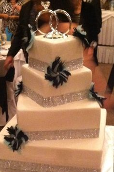 Wedding cake. Love the rings on top!