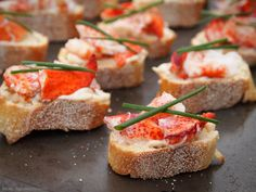 (Reinvented) Lobster Rolls: lobster, aioli, chives on baguette bread.