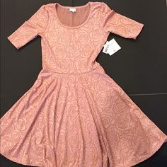 Dusty Pink LulaRoe Nicole Dress! Pristine, rare jacquard BNWT Nicole dress from Lularoe. Size Medium. For reference, I wear a 6-8 top and an 8-10 bottom. Has some stretch. Beautiful dusty pink color. Rare pattern is a textured rose pattern. Gorgeous dress, just not the best color on me. Perfect for spring! LuLaRoe Dresses Midi