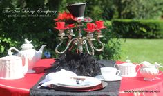 black & red mad hatter tea party table set up