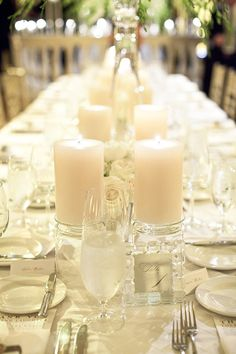 Long table with lots of thick candles