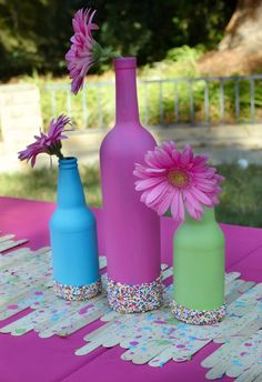 Great ideas for a baby sprinkle - sprinkle dipped bottles for table.