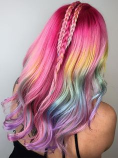 The latest rainbow hair-color trend to take over Instagram will give you all the 90s nostalgia: Lisa Frank hair is here and it will make you want to head straight to the hair salon.