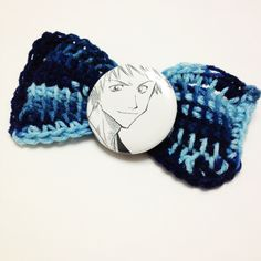 """This kawaii crochet hair bow features Ichigo from Bleach.    Crochet hair bow is made out of acrylic yarn and has a 2.25"""" button.  Comes with a secure hair clip.    Item is ready to ship upon purchase."""