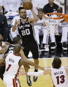 The San Antonio Spurs' Manu Ginobili (20) shoots against the Miami Heat during the first half in Game 7 of the NBA basketball championships, Thursday, June 20, 2013, in Miami