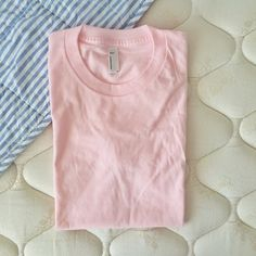 """AA Pink Fine Jersey Cotton Tee A pink 100% cotton tee by American Apparel. """"The softest, smoothest, best-looking T-shirt available anywhere."""" In women's sizing. New, never worn. American Apparel Tops Tees - Short Sleeve"""