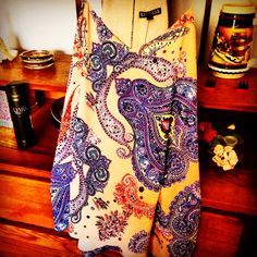 Express polyester tank with a gorgeous paisley print. Purposely oversized. Looks great with jeans shorts or leggings