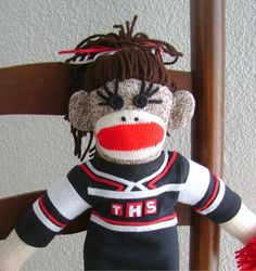 Super fun gift for the Cheerleader in your life!  I can personalize your monkey's outfit to match any cheer outfit!!  :)  Personalized Cheerleader Sock Monkey by DeedleDeeCreations on Etsy, $35.00