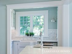 A space just for clean-up... in this traditional light  bright kitchen remodel.