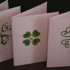 Green thumbprint shamrocks with rhinestone center.
