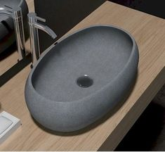 Made from the highest quality marble, the basin's clean lines and smooth surface glide seamlessly together to create this beautiful bowl, ideal for a design statement. This piece will complement any interior style, boasting its refinement. Match the bowl with our other interior products for a cohesive interior aesthetic. A worthy investment, whether you are designing a new luxury bathroom, or upgrading your old home, this robust bowl will last through the decades. Dimensions: 550 x 350 x…