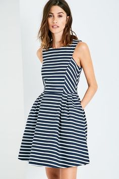 Jasmin Striped Fit & Flare Dress.   The Jasmin is a flared dress, with a regular scooped neckline, which is fitted to the body for a feminine, figure-hugging silhouette. This fit and flare style is an absolute wardrobe staple and an easy go-to option for your warm weather looks.