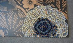 Bottle Cap Art fabric blown up and put on panels