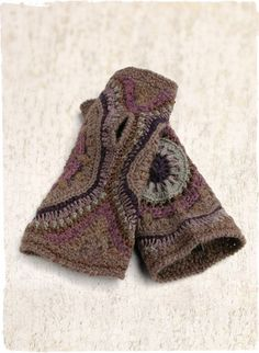 The adorable cold-weather accessory, handcrocheted in concentric circles of plum, mauve, grey and soft blue; baby alpaca (42%), alpaca (25%), pima (25%), viscose from bamboo (6%) and silk (2%). Coordinates with our Nazca Alpaca Hat.