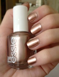 """I'm not super intro nail stuff. The only polishes I tend to like are either metallic, blue, or bright red. However this Essie """"Penny Talk"""" is somethin' special: a cross between a light rose gold and a shiny penny."""