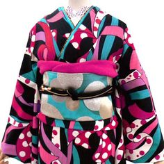 Another kimono from Wafukan Kimono utilizing their signature graphic style and the motif of ribbons they use on their furisode as well. Thi...