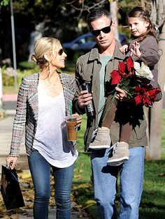 Sarah Michelle Gellar and husband Freddie Prinze Jr. take daughter Charlotte, 4, on a quiet walk in Los Angeles on December 16, 2013.