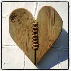 This heart is made of driftwood given back from the sea. The piece is actually a minty turquoise colour, must have been painted once. The two pieces of wood are bound together by natural cotton twine - a symbol of two parts becoming one bound by love... Hang anywhere in the home. 1kg,