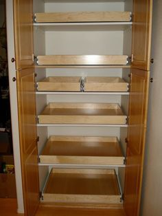 I would love to have my pantry set up like this. Pull out drawers makes so much sense. You won't have to practically get down on your hands and knees to get to the food on the bottom shelf!