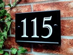 Rectangular reflective house number plaque available in black, ultramarine blue, green and burgundy with optional gold rim. These Classic Rectangle House Number Signs have been designed to look like traditional cast iron plaques with a rai. Slate House Numbers, House Number Plates, Door Numbers, Outdoor Signage, Outdoor Decor, House Names, Name Plaques, Extreme Weather, Home Signs