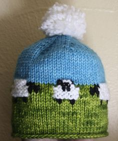 This hat is designed to coordinate with Jennifer Little's Sheep Yoke Baby Cardigan. The sheep motifs are used with her permission.