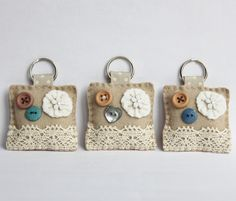 A Vintage Style Button keyring. handy to keep your keys safe or to hang off a handbag or child's book bag. These keyrings has been lovingly hand sewn using wool blended felt, embellished with a lovely ivory flower, cute little buttons and finished of Felt Crafts, Fabric Crafts, Sewing Crafts, Sewing Projects, Button Art, Button Crafts, Felt Keyring, Key Fobs, Hobbies And Crafts
