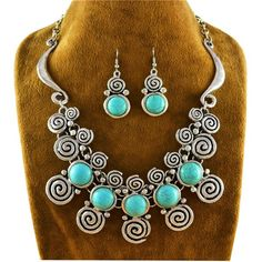Striking silver and faux turquoise necklace and earring set