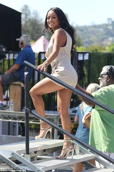 Work it: Chris Brown's ex-girlfriend added height to her petite frame with…