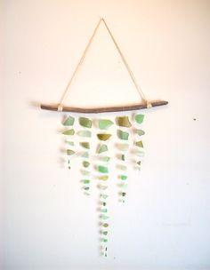 Sea glass mobile// Boho beach decor// Shades of green by RedIslandSeaGlass on Etsy #seaglass #seaglassmobile #seaglasssuncatcher #suncatcher #chime #seaglassart #boho #zen #wallhanging #oceaninspired #beachdecor #art