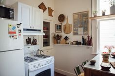 The kitchen's deep built-in cabinet houses the couple's collection of Le Creuset and antique cast iron.