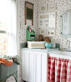 Kolene designed the laundry room's clothespin-print wallpaper for York, and painted the matching ironing-themed art.