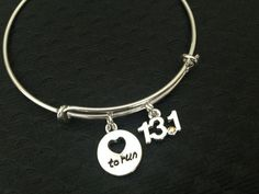 Sterling Silver Plated 13.1 Charm with Austrian Crystal. Love to Run Silver Plated Charm. Both Charms are securely attached to a Silver Plated Expandable Adjustable Bangle Bracelet. Runners Charm Bang